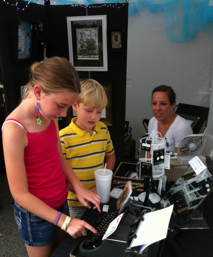 """Jessica and Wyatt try out my old ypewriter, as my daughter and """"assistant shopkeeper"""" Morgan looks on."""