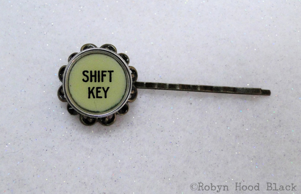 shift key filigree bobby pin with c