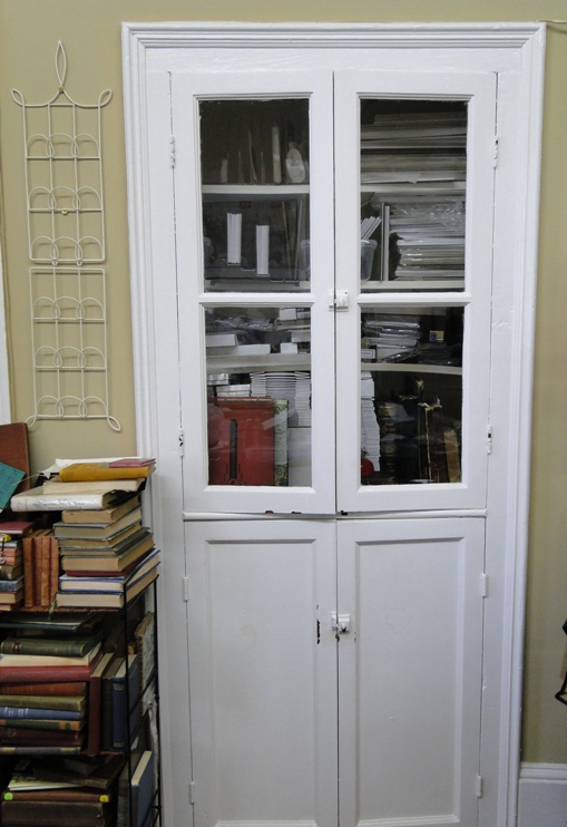 glass front cabinet and books