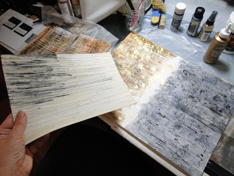 working on mixed media substrates, with the help of some Italian wallpaper...!